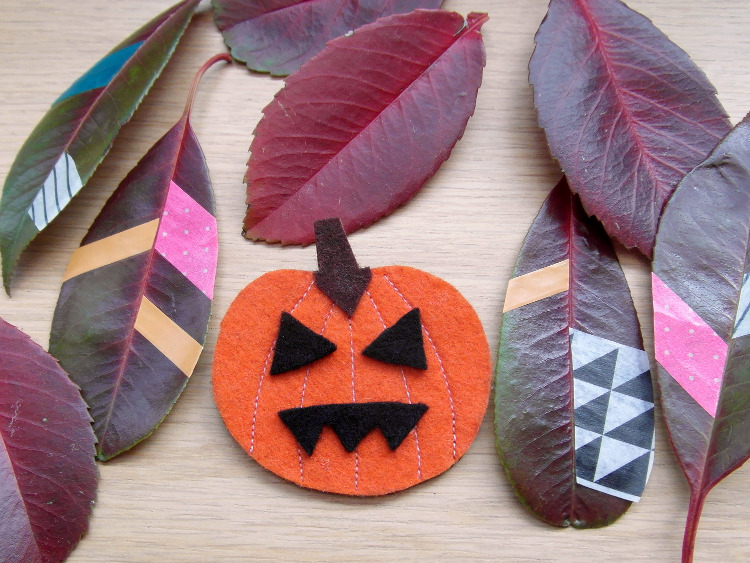 Decorated leaves and felt pumpkin badge