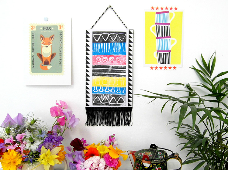 Handmade bright aztec wall hanging