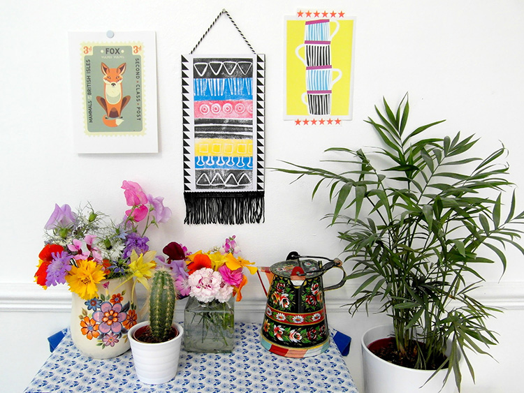 Bright aztec wall hanging created using ink pads and a moldable foam stamp