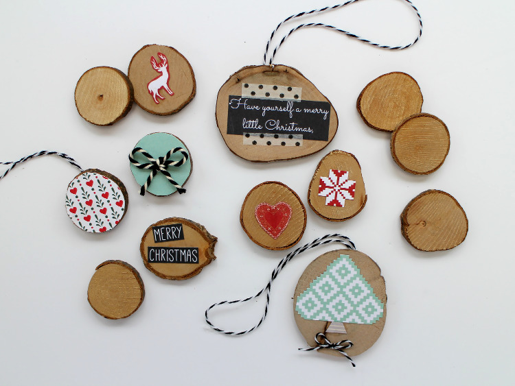 Wooden discs decorated with scrapbook paper