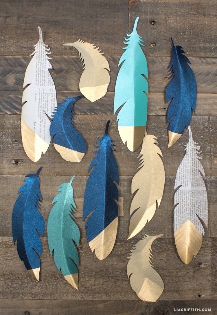 Gold tipped paper feathers make great decorations for gifts or garlands