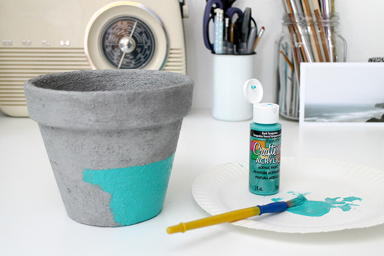 Painting the concrete pot with acrylic paint