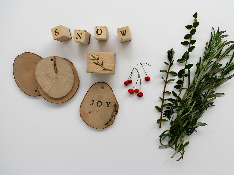 Wooden discs, letter stamps and winter foliage