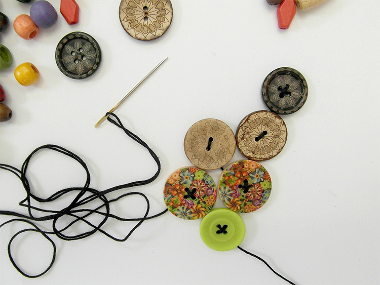 Stringing wooden buttons