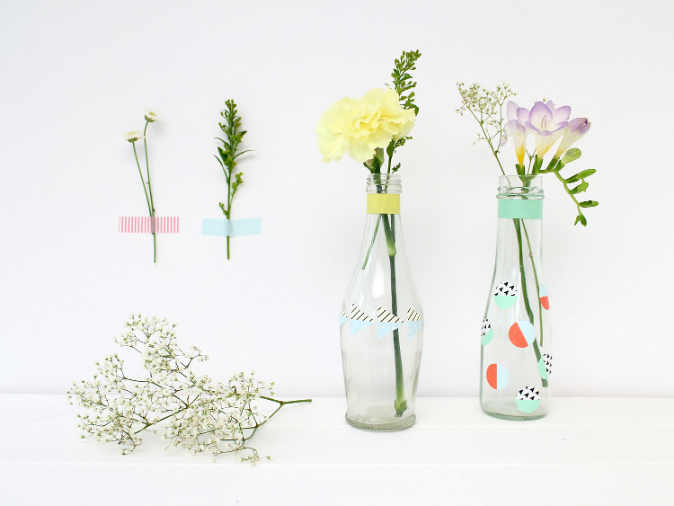 Bottles decorated with DIY washi tape stickers