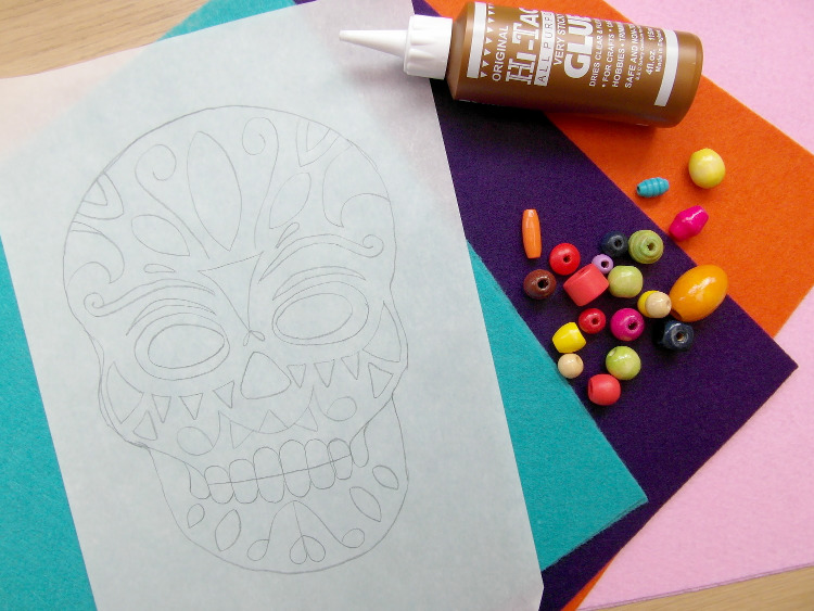 Coloured felt and a skull template used to make a Day of the Dead mask