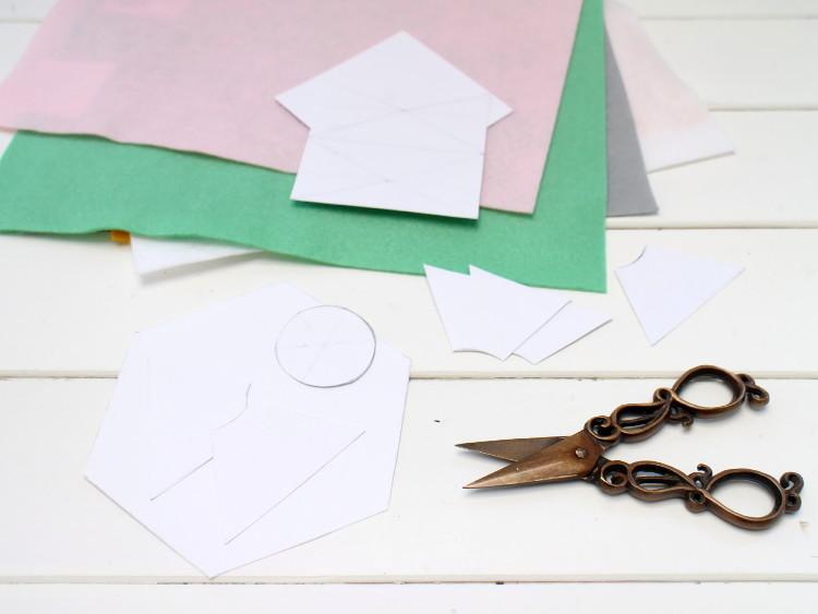 Decide on your shapes and cut them out of white cardboard