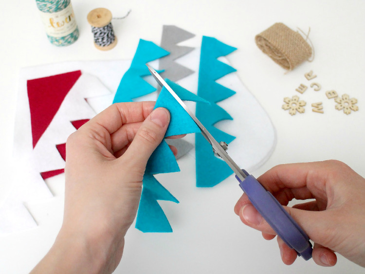 Cut out your felt shapes and arrange them in place