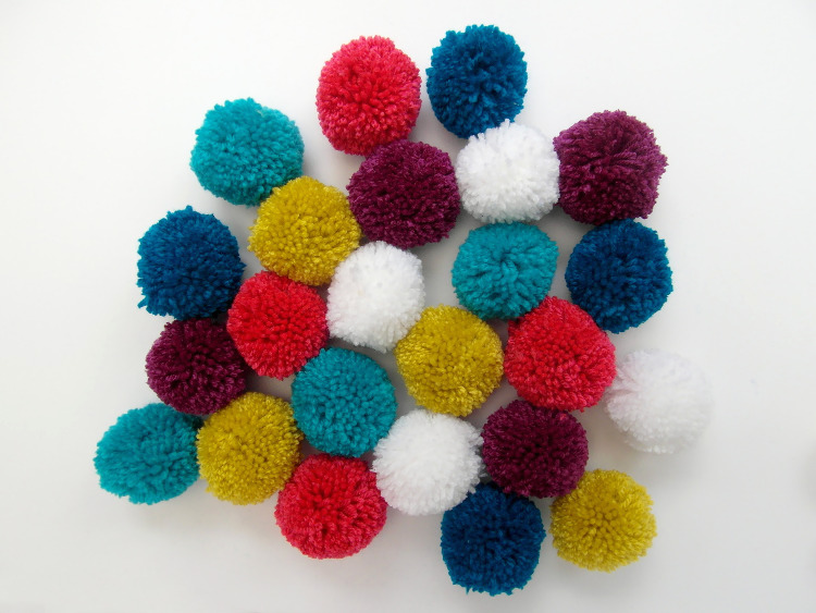 Colourful woollen pompoms