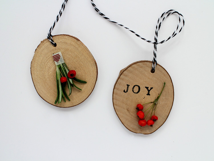 Wooden disc decorations with berries and foliage