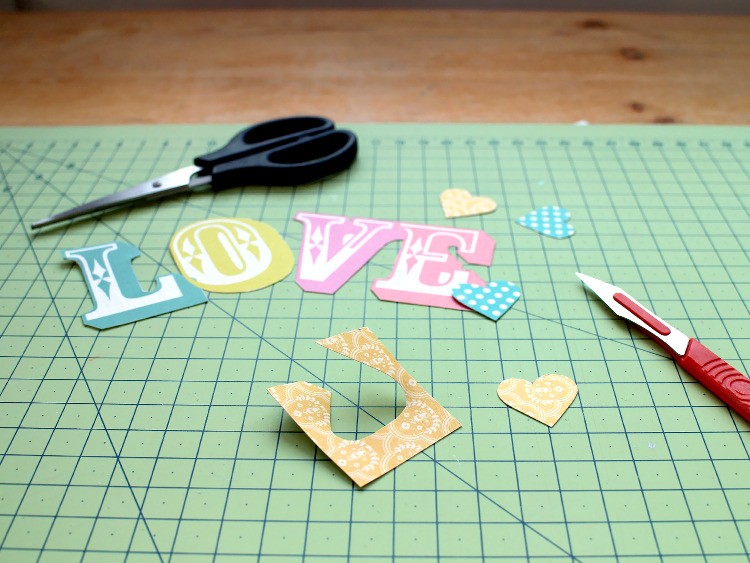 Cutting out the paper letters and hearts