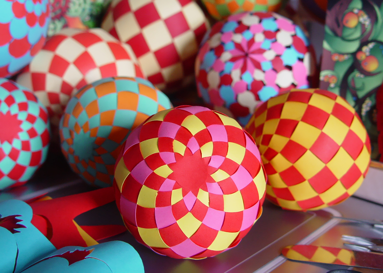 Woven paper ball decorations