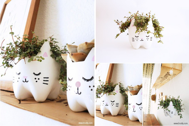 Cat planters made from painted plastic bottles