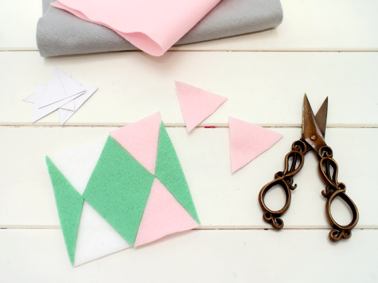 Arrange the felt pieces and glue them down