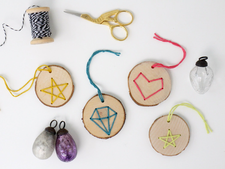 Stitched wooden disc decorations