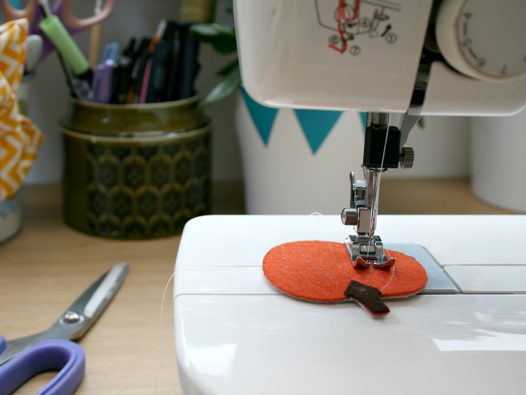 Stitching the detail on the felt pumpkin