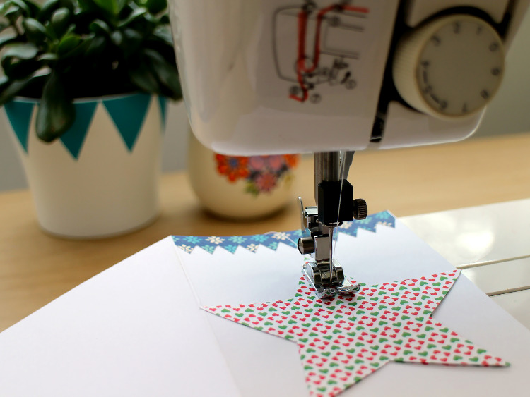 Stitching the scrapbook paper shapes into place