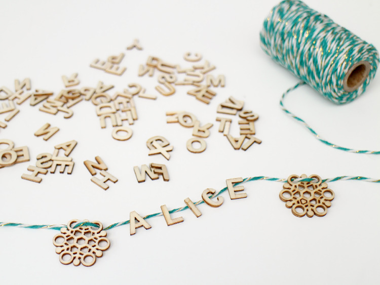 Sort your wooden letters and glue them to the twine
