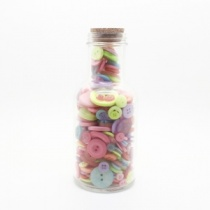 Bottle of pastel buttons