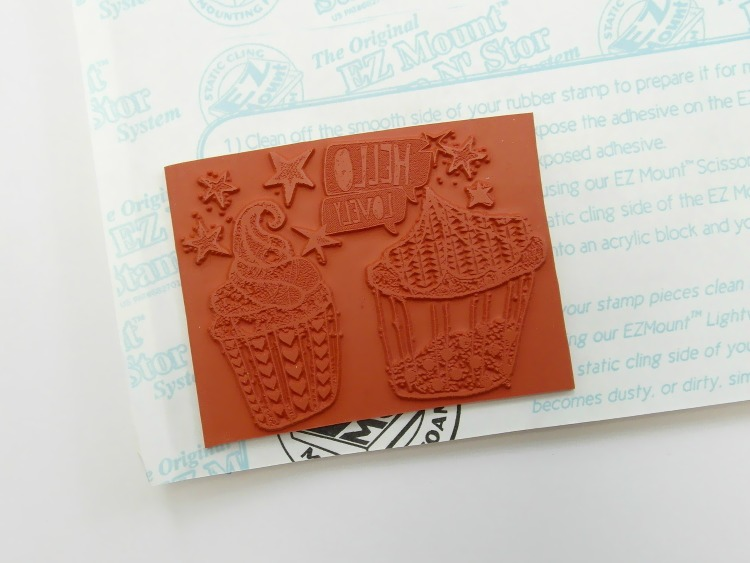 An unmounted stamp with foam mount in the background